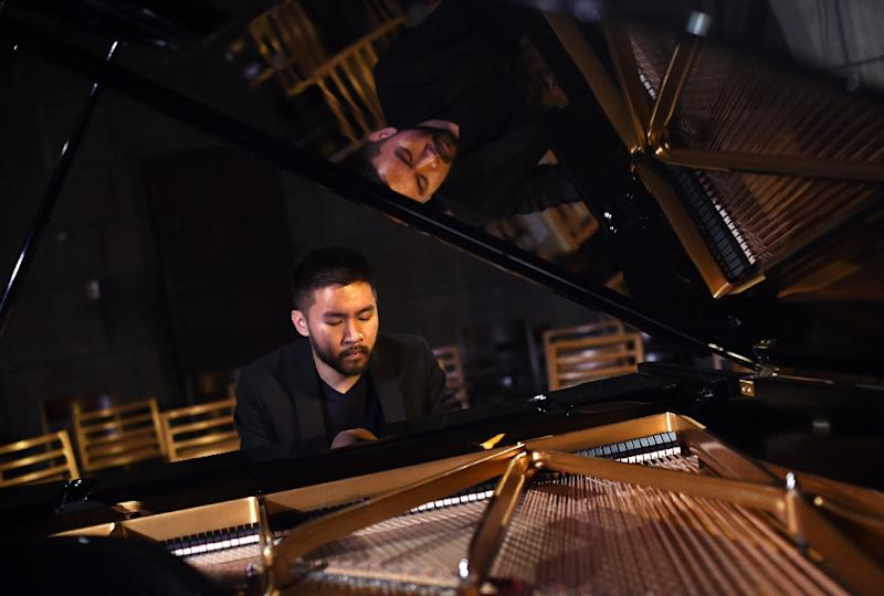 The 2018-19 New York Philharmonic season will include a commissioned piece from 23-year-old piano prodigy Conrad Tao (AFP Photo/TIMOTHY A. CLARY)