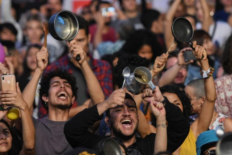 People bang pans and pots at a concert in support of the strike against President Ivan Duque's government in Medellin, Colombia on December 1, 2019