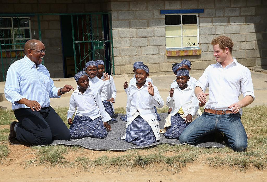 Prince Harry ditched his formal wear for blue jeans when he had some fun with a group of children at the Kananelo Centre for the Deaf in the African nation of Lesotho on Wednesday. Prince Harry along with Prince Seeiso of Lesotho helped create the school via their joint charity called Sentebale, which focuses on children in need. (2/27/2013)