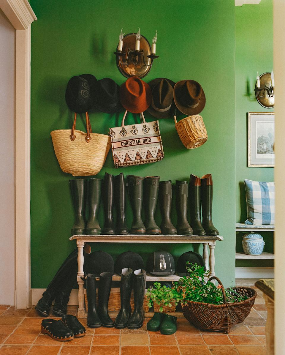 "<div class=""caption"">Wellies lined up in the mudroom.</div><cite class=""credit"">Matthieu Salvaing</cite>"