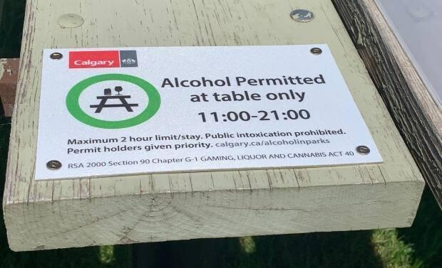The City of Calgary is launching its alcohol in parks program, running June 1 to Sept. 7, 2021. Signs are posted on designated picnic tables in city parks explaining the rules. (Mike Symington - image credit)