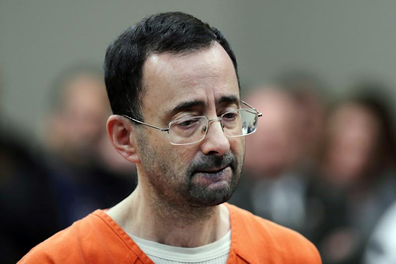 Ex-Michigan State coach convicted in case tied to Nassar