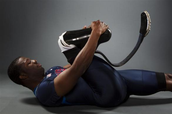 Paralympic sprinter Jerome Singleton stretches while posing for a portrait during the 2012 U.S. Olympic Team Media Summit in Dallas, May 15, 2012.