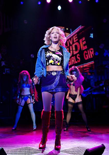 "This undated publicity photo released by the Vivacity Media Group shows Kate Rockwell in a scene from ""Rock of Ages."" The cast of the Broadway show will be part of the televised pregame entertainment before Sunday's Super Bowl on Feb. 2, 2014. (AP Photo/Vivacity Media Group , Paul Kolnik)"