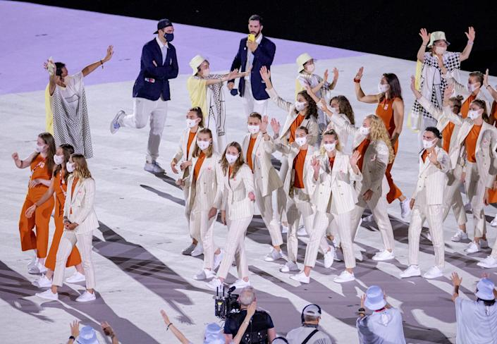 Dutch athletes wave during the opening ceremony of the Olympic Games.