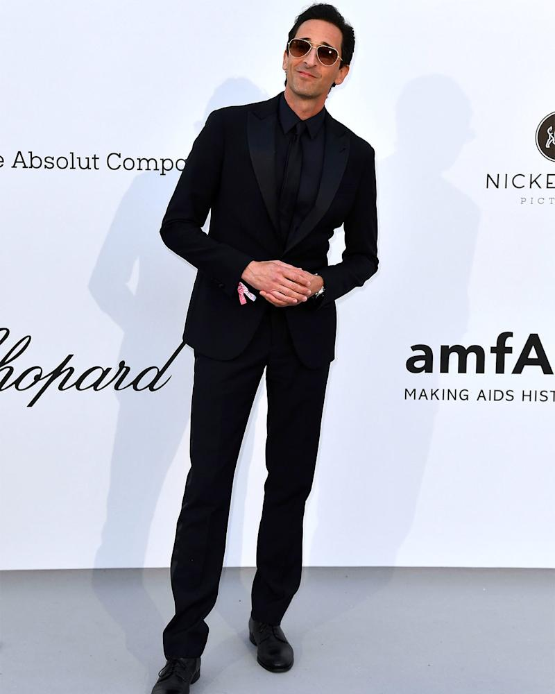 We should all aspire to feel as content in black tie as Adrien Brody seems to.