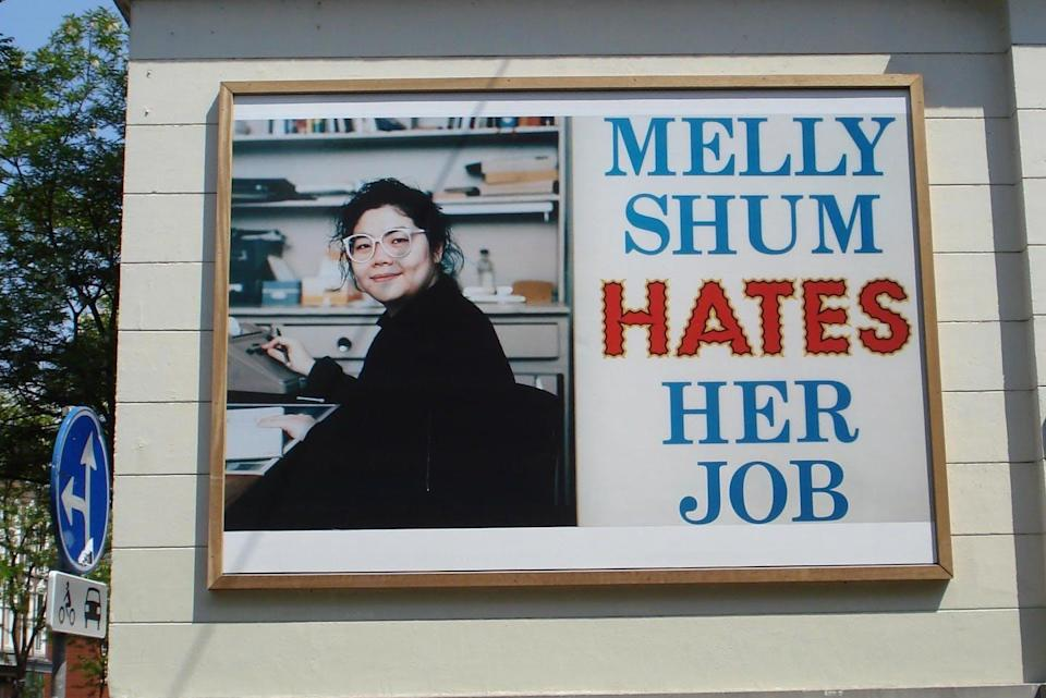 """<span class=""""caption"""">Artwork 'Melly Shum Hates Her Job' by Ken Lum hangs in the Witte de Withstraat district in Rotterdam, The Netherlands, shown May 2008.</span> <span class=""""attribution""""><span class=""""source"""">(Ken Lum/Wikimedia Commons)</span></span>"""