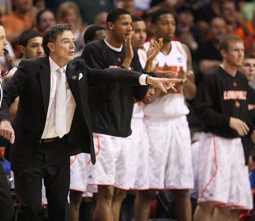 Louisville head coach Rick Pitino, left, directs his team against Florida in the closing moments of the second half of an NCAA tournament West Regional final college basketball game on Saturday, March 24, 2012, in Phoenix. Louisville won the game 72-68. (AP Photo/Matt York)