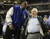 Former NBA player Magic Johnson, left, laughs with Tommy Lasorda between innings of baseball's Game 3 of the National League Division Series between the New York Mets and the Los Angeles Dodgers, Monday, Oct. 12, 2015, in New York. (AP Photo/Julie Jacobson)