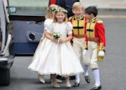 <p>The bridesmaids wore dresses designed by Nicki Macfarlane while the page boys dressed in Foot Guards officer-inspired uniforms, in a red fabric to match Prince William's outfit.</p><p>It is believed that the bridesmaids' ivy and lily-of-the-valley hair wreaths were inspired by the bride's mother's headdress at her 1981 wedding to Michael. </p>