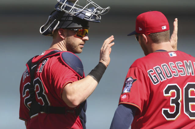 Minnesota Twins catcher Mitch Garver, left, and Robbie Grossman celebrate the Twins 10-1 win over the Baltimore Orioles in a baseball game Sunday, July 8, 2018, in Minneapolis. (AP Photo/Jim Mone)