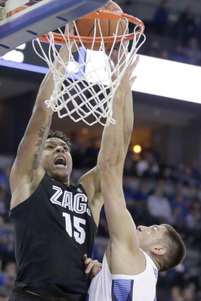 Gonzaga's Brandon Clarke (15) is fouled by Creighton's MartinKrampelj, right, during the first half of an NCAA college basketball game in Omaha, Neb., Saturday, Dec. 1, 2018. (AP Photo/Nati Harnik)