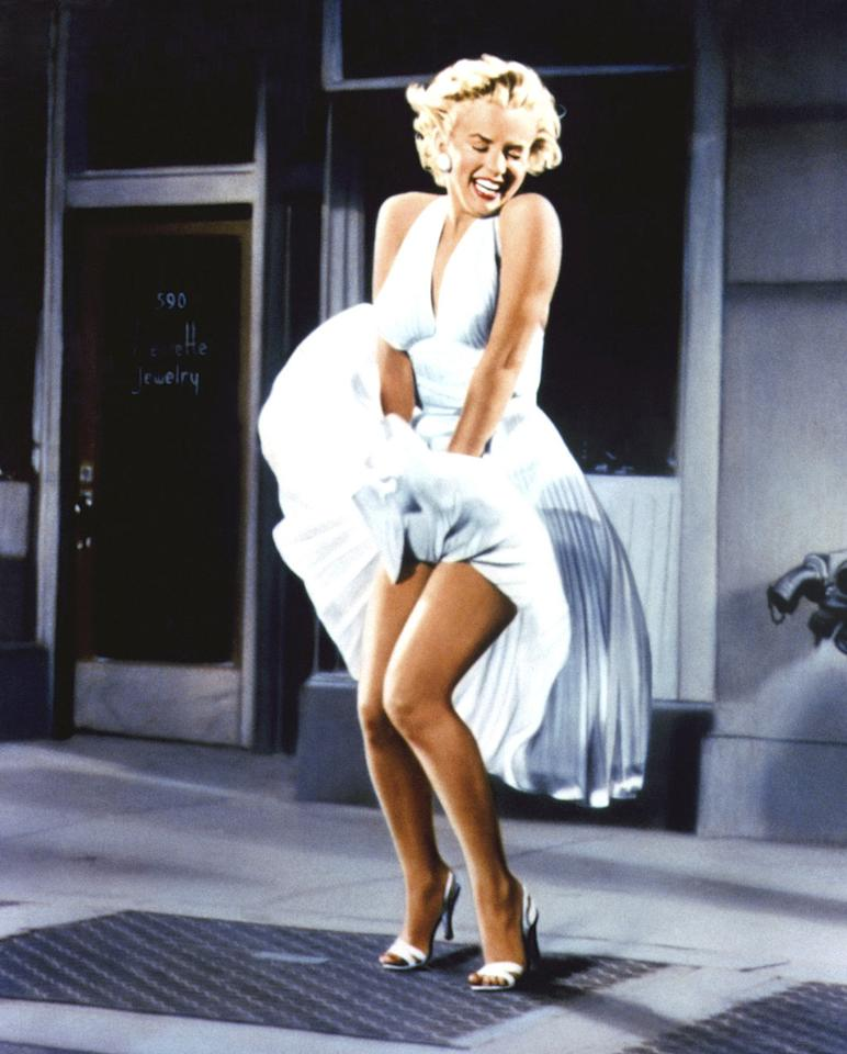 """""""<a href=""""http://movies.yahoo.com/movie/the-seven-year-itch/"""">The Seven Year Itch</a>"""" (1955): Very few images earn the hyperbolic, over-used adjective of """"iconic,"""" but the sight of Marilyn Monroe standing over a subway grate, letting the breeze blow up her billowing white dress, truly does. Monroe's playfully seductive charms were on full display in Billy Wilder's comedy, based on the long-running stage show, as the flirtatious neighbor who tempts the married Tom Ewell during a long, hot New York summer. Cooling off with air conditioning and a glass of ice water isn't nearly so sexy."""