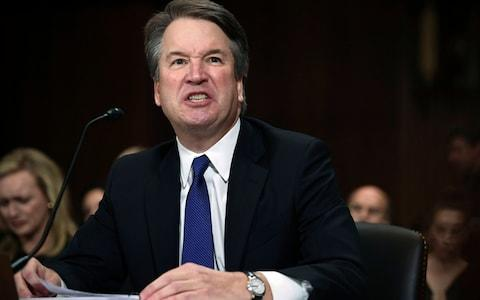Supreme Court nominee Judge Brett Kavanaugh gives his opening statement before the Senate Judiciary Committee - Credit: AFP