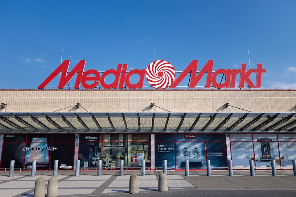 Amberg, Germany - August 9, 2020: Media Markt store in Amberg, Bavaria, Germany, Europe. Media Markt is a german chain, selling consumer electronics, with headquarter in Ingolstadt. It belongs to the Media-Saturn holding. Logo on the building and advertising on the facade. Sunny summer day with blue sky.