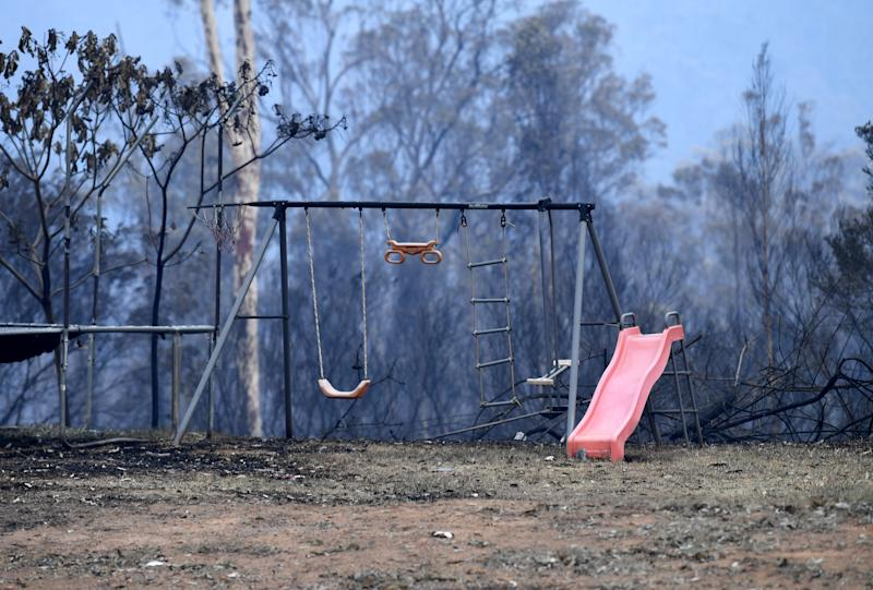 Children's play equipment is seen on a property destroyed by bushfire.