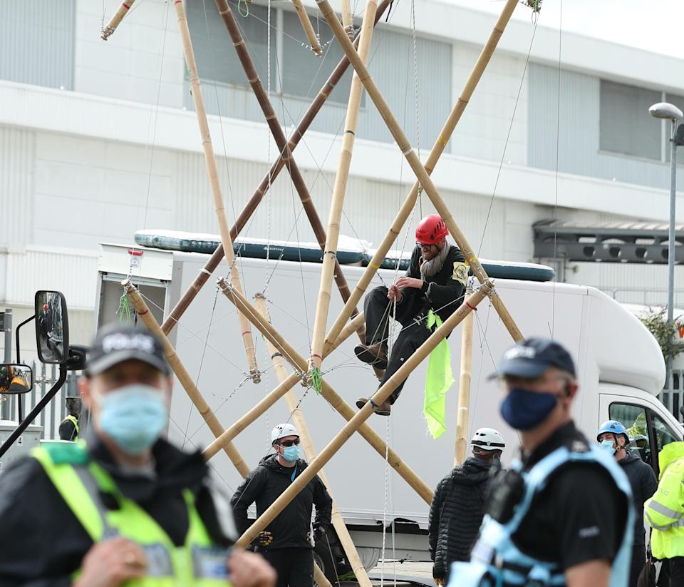 Protesters used bamboo lock-ons to block the road outside the newsprinters at Broxbourne, Hertfordshire. (PA)
