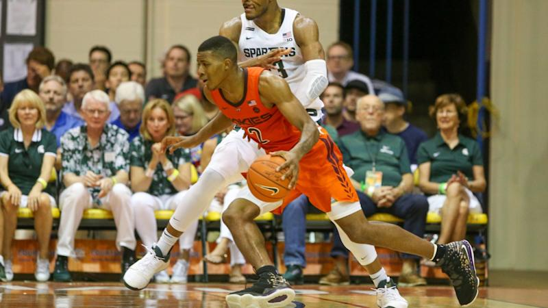 Spartans upset by unranked Virginia Tech in Maui