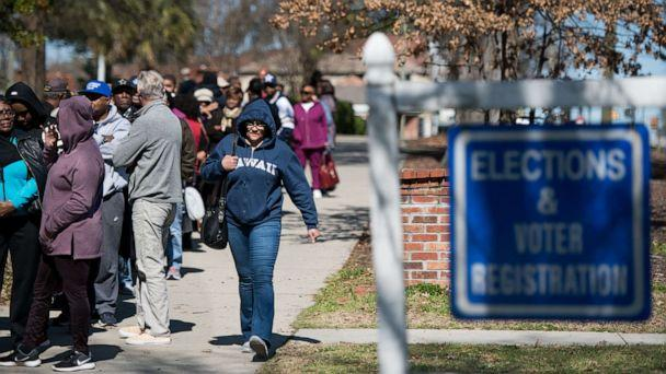 PHOTO: South Carolina voters stand in line for early voting at the Richland County Election Commission, Feb. 27, 2020, in Columbia, S.C. (Sean Rayford/Getty Images)