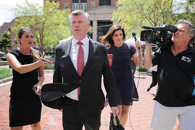 <p>Kevin Downing, lead attorney for former Trump campaign chairman Paul Manafort, is pursued by reporters after leaving the Albert V. Bryan U.S. Courthouse during the eleventh day of Manafort's trial on Aug. 14, 2018 in Alexandria, Va. (Photo: Chip Somodevilla/Getty Images) </p>