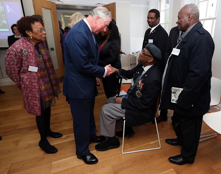 LONDON, ENGLAND - FEBRUARY 16: Prince Charles, The Prince of Wales meets veteran Allan Wilmot (centre) amongst other veterans during his visit to the Black Cultural Archives in Brixton on February 16, 2017 in London, England.  (Photo by Jonathan Brady / WPA Pool - Getty Images)