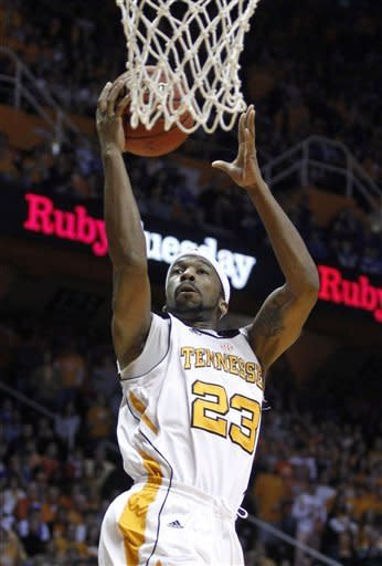 Tennessee's Cameron Tatum (23) shoots in the first half of an NCAA college basketball game against Kentucky on Saturday, Jan. 14, 2012, in Knoxville, Tenn. (AP Photo/Wade Payne)