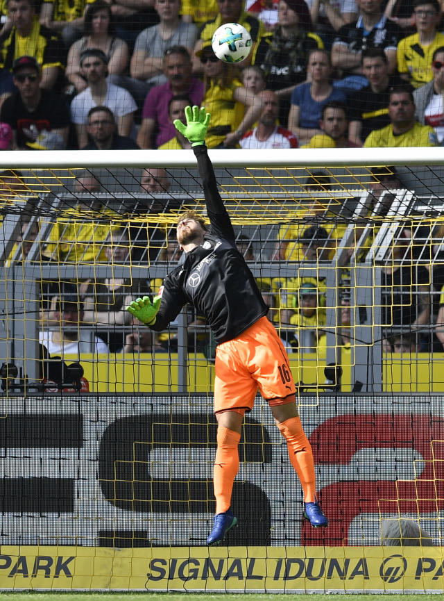 Stuttgart goalkeeper Ron-Robert Zieler receives the opening goal by Dortmund's Christian Pulisic during the German Bundesliga soccer match between Borussia Dortmund and VfB Stuttgart in Dortmund, Germany, Sunday, April 8, 2018. (AP Photo/Martin Meissner)