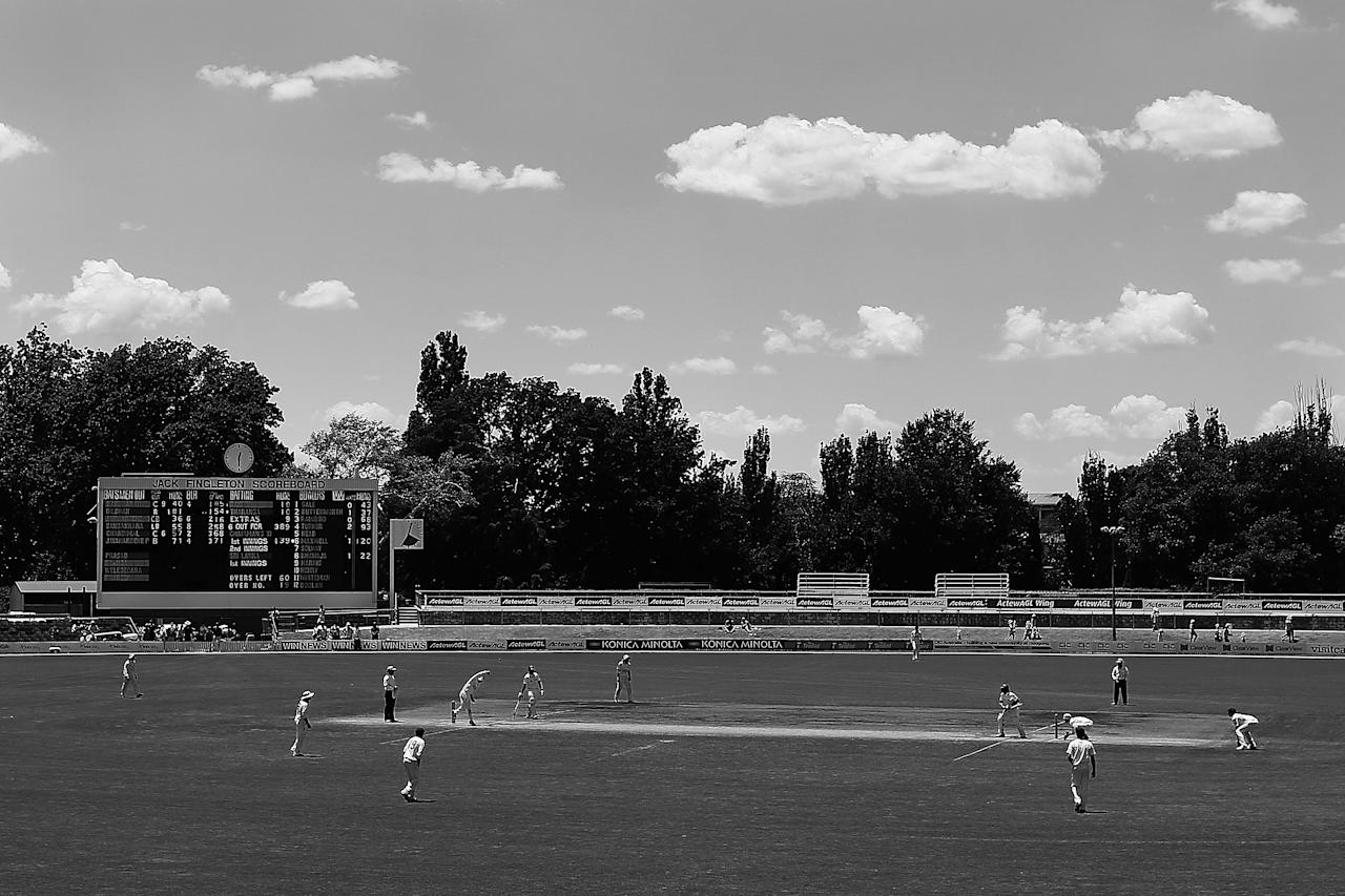 CANBERRA, AUSTRALIA - DECEMBER 08:  (EDITORS NOTE: Image has been converted to Black & White) The Jack Fingleton Scoreboard stands behind play during an international tour match between the Chairman's XI and Sri Lanka at Manuka Oval on December 8, 2012 in Canberra, Australia. The Jack Fingleton Scoreboard was first erected at the MCG in 1901. In 1982 it was replaced by an electronic board and donated to the Manuka Oval by the Melbourne Cricket Club as memorial to J.H.W Fingleton OBE.  (Photo by Brendon Thorne/Getty Images)