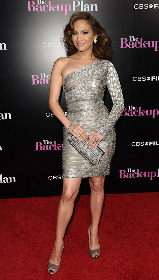 """Jenny from the Block rocked the red carpet at Wednesday night's Los Angeles premiere of """"The Back-Up Plan"""" in a fabulous one-shoulder Gianfranco Ferre frock. Mrs. Marc Anthony accessorized with stunning satin Ferragamo peep-toes and a studded Christian Louboutin clutch."""