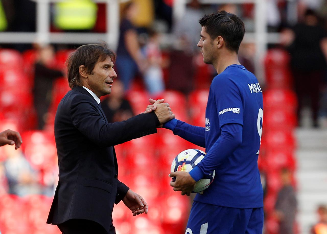 "Soccer Football - Premier League - Stoke City vs Chelsea - bet365 Stadium, Stoke-On-Trent, Britain - September 23, 2017   Chelsea manager Antonio Conte shakes hands with Chelsea's Alvaro Morata after the match    Action Images via Reuters/Craig Brough    EDITORIAL USE ONLY. No use with unauthorized audio, video, data, fixture lists, club/league logos or ""live"" services. Online in-match use limited to 75 images, no video emulation. No use in betting, games or single club/league/player publications. Please contact your account representative for further details."