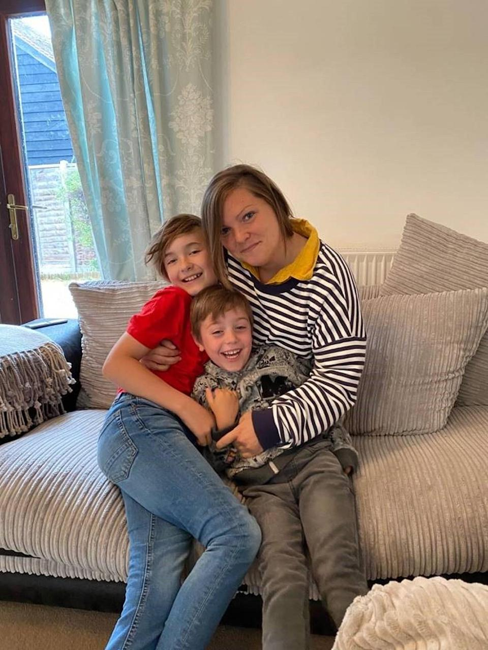 Sarah Smith, pictured with her nephews, gave a home to a child during the coronavirus pandemic