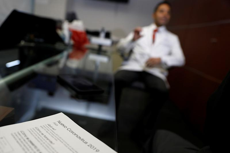 Information about the new coronavirus is seen on the desk of doctor Jorge Baruch Diaz inside a clinic at Benito Juarez international airport in Mexico City, Mexico January 22, 2020. REUTERS/Carlos Jasso