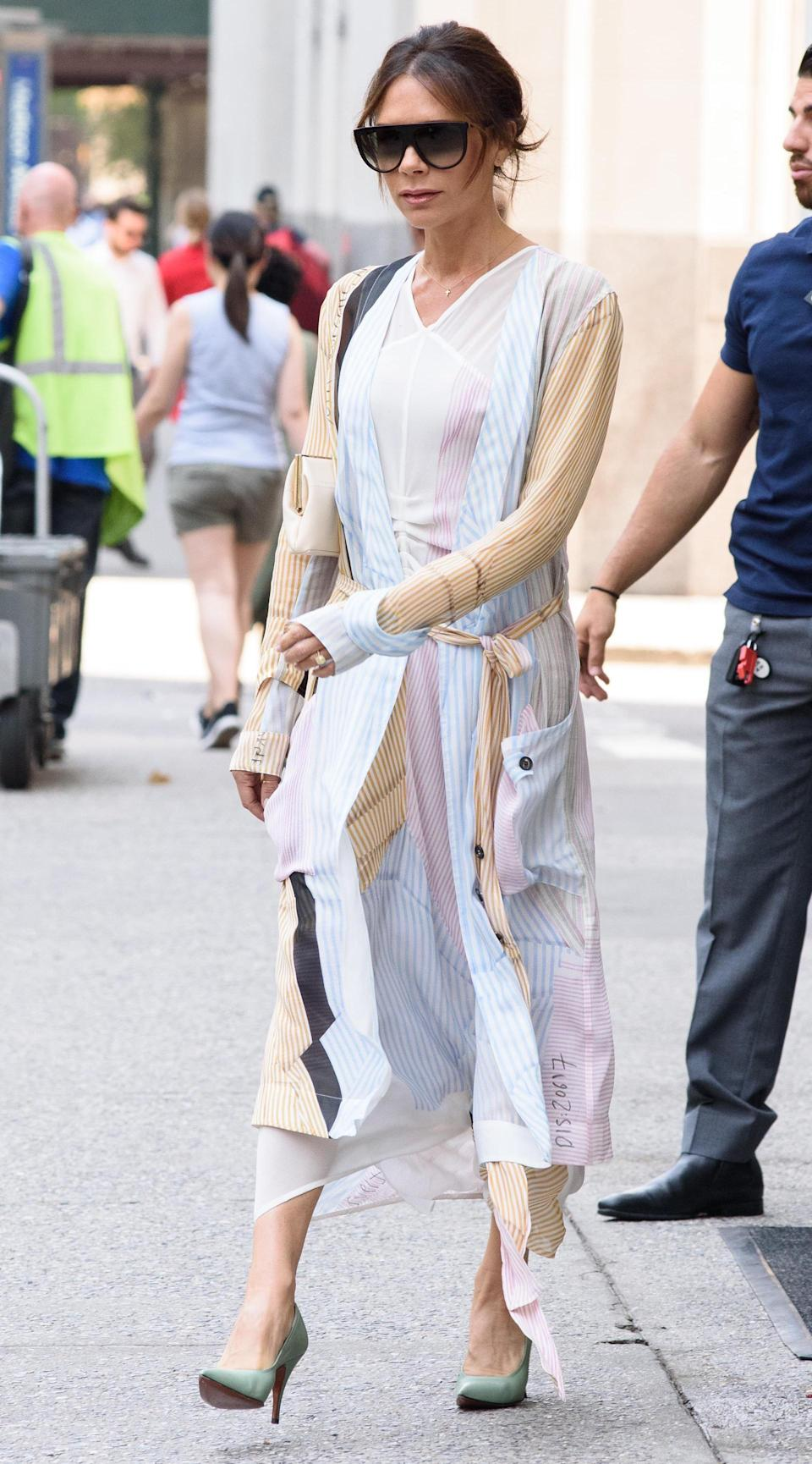 <p>Victoria Beckham was photographed out and about in New York wearing a striped ensemble by her eponymous label. Hands up, who else is in serious need of this look? <em>[Photo: Rex]</em> </p>