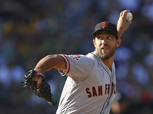 San Francisco Giants pitcher Madison Bumgarner works against the Oakland Athletics during the first inning of a baseball game Saturday, July 21, 2018, in Oakland, Calif. (AP Photo/Ben Margot)