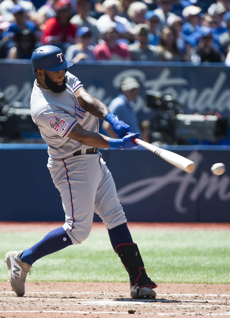 Texas Rangers' Danny Santana hits a two-run double against the Toronto Blue Jays during the fourth inning of a baseball game in Toronto, Wednesday, Aug. 14, 2019. (Nathan Denette/The Canadian Press via AP)