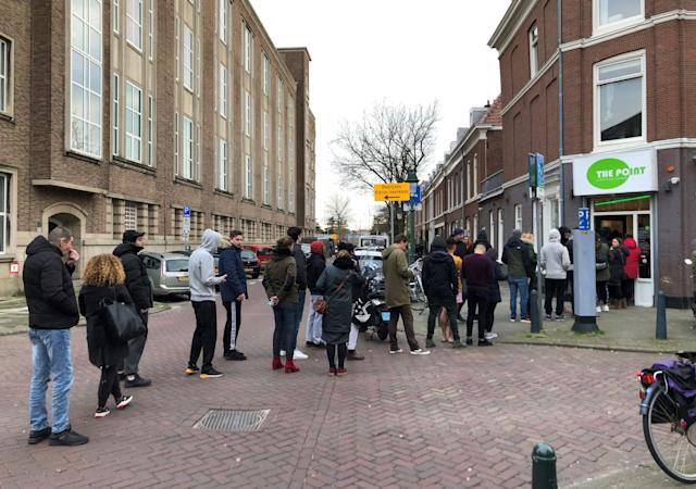 People queue outside a cannabis coffee shop on Sunday in The Hague, the Netherlands (AFP via Getty Images)