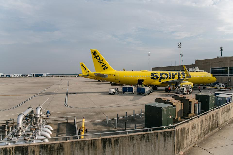 HOUSTON, TEXAS - AUGUST 05: Spirit Airlines aircrafts are shown at the George Bush Intercontinental Airport on August 05, 2021 in Houston, Texas. Spirit and American Airlines have been forced to cancel hundreds of flights in recent days as the demand for vacation and other travel plans has surged following the ramp up of Covid-19 vaccinations. Some of the cancellations come amid a weekend of storms that affected hubs for both carriers, but also a shortage of flight crews due to the ramp up in service is having an effect. (Photo by Brandon Bell/Getty Images)