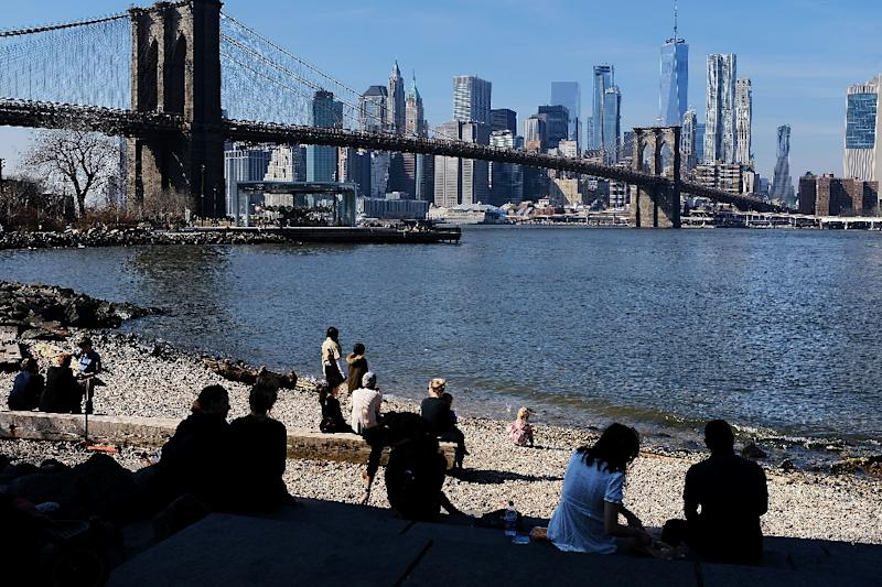 People enjoy a Brooklyn park as they get a taste of spring with record high temperatures in New York City