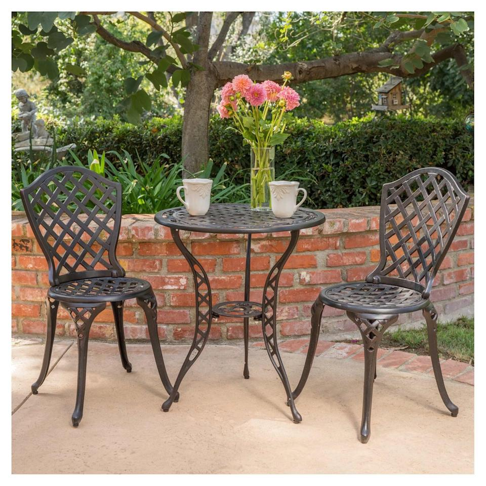 <p>Sit outside, have some tea, and read a book with this sophisticated-looking <span>La Sola Metal Bistro Set</span> ($210).</p>