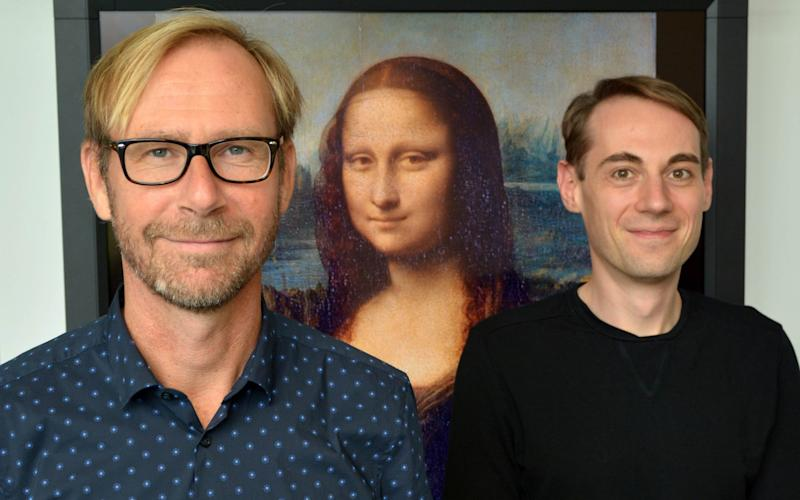 Prof Gernot Horstmann and Dr Sebastian Loth pictured between the Mona Lisa  - CITEC/ Bielefeld University