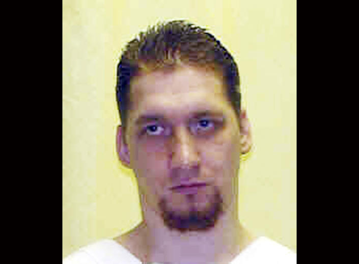 FILE - This undated file photo provided by the Ohio Department of Rehabilitation and Correction shows Ronald Phillips. Ronald Phillips, 40, was scheduled to be put to death Thursday Nov. 14, 2013 with a lethal injection of a two-drug combination not yet tried in the U.S., but Gov. John Kasich issued a stay of execution to consider the inmate's unprecedented organ donation request, Wednesday. The execution date has been reset for July 2. (AP Photo/Ohio Department of Rehabilitation and Correction, File)