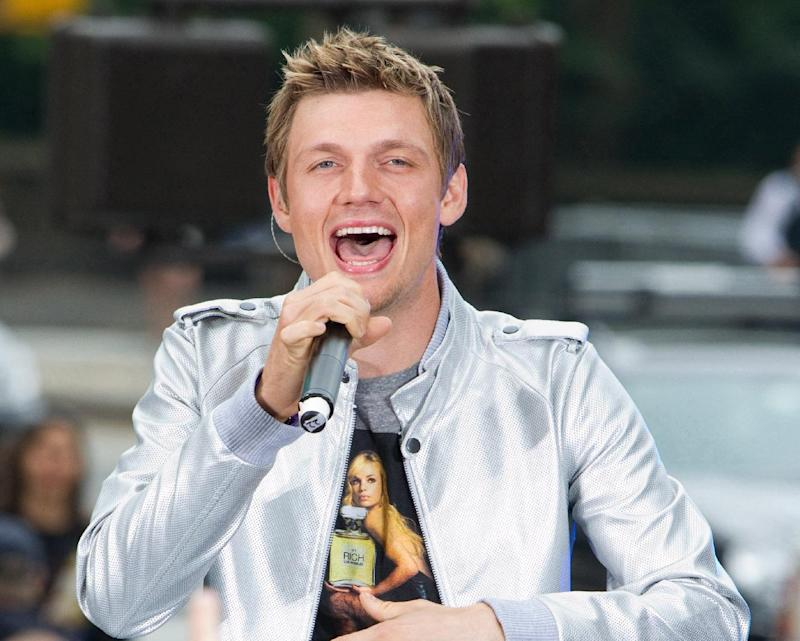 """FILE - This May 24, 2010 file photo shows Nick Carter of the Backstreet Boys performing on CBS News' """"The Early Show"""" in New York. The Backstreet Boys singer proposed to his fitness trainer girlfriend Lauren Kitt in February, and he says they may bring their marriage to the small screen. """"There have been offers and opportunities to film the actually wedding, like a TV show,"""" the 33-year-old said in a recent interview. The couple appears together in a series of fitness webisodes called """"Kit Fitt."""" (AP Photo/Charles Sykes, file)"""