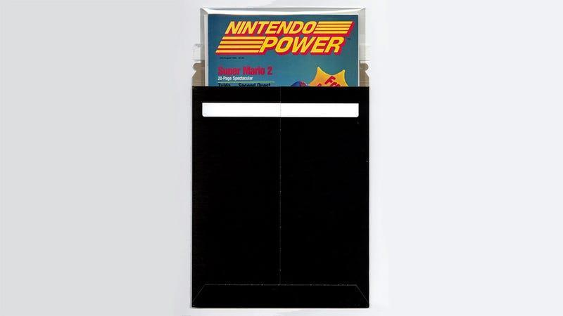 A black mailing sleeve containing a copy of the first Nintendo Power magazine.