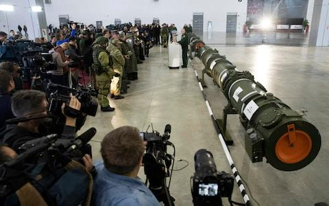 Russia shows journalists and military attaches the 9M729 missile outside Moscow in January - Credit: Pavel Golovkin/AP