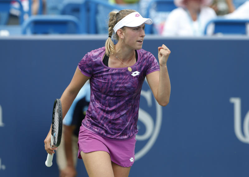 Elise Mertens, of Belgium, pumps her fist after winning a game against Caty McNally during first round play at the Western & Southern Open tennis tournament, Monday, Aug. 12, 2019, in Mason, Ohio. (AP Photo/Gary Landers)