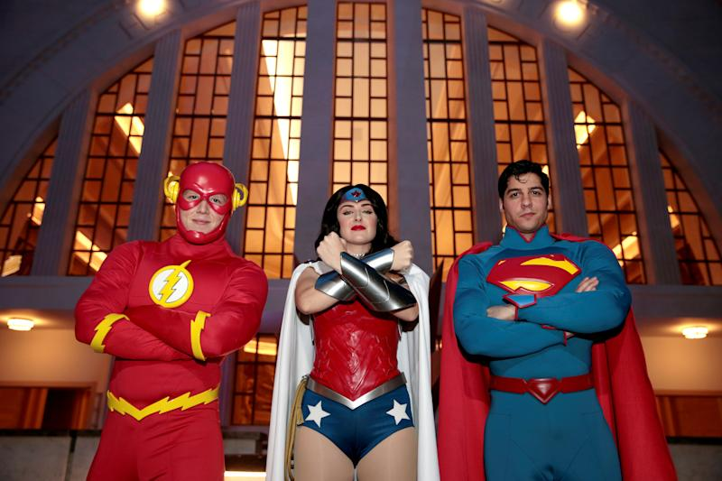 Park staff dressed as The Flash, Wonder Woman and Superman are seen at Warner Bros. World Abu Dhabi theme park in Abu Dhabi, United Arab Emirates April 18, 2018. REUTERS/Christopher Pike