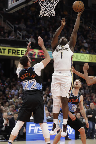 New Orleans Pelicans' Zion Williamson (1) shoots next to Cleveland Cavaliers' Larry Nance Jr. (22) during the second half of an NBA basketball game Tuesday, Jan. 28, 2020, in Cleveland. (AP Photo/Tony Dejak)