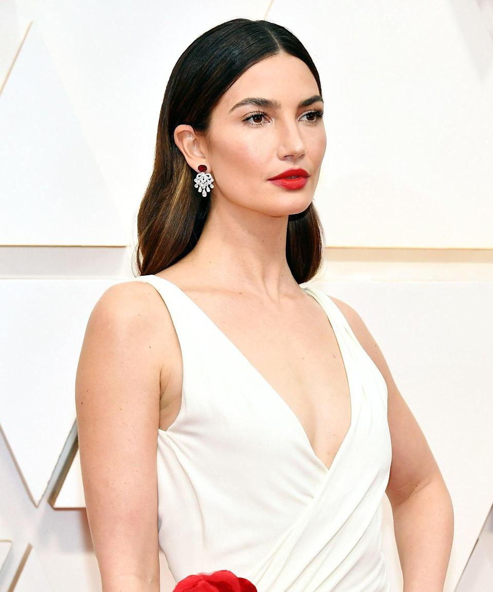 "<strong>Lily Aldridge, 2020</strong><br><br>The former Victoria's Secret model was the picture of glamour at last season's award show, proving that a <a href=""https://www.refinery29.com/en-us/2021/02/10319167/side-part-hairstyle-tiktok-gen-z"" rel=""nofollow noopener"" target=""_blank"" data-ylk=""slk:middle part"" class=""link rapid-noclick-resp"">middle part</a> and hair tucked behind your ears is a chic styling win every time."