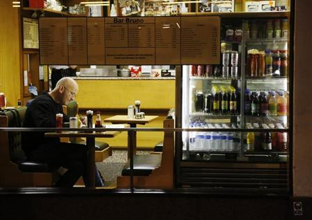 A man sits in a cafe in London