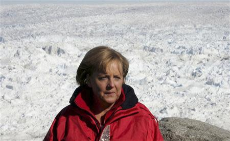 File photo of German Chancellor Angela Merkel standing next to the Eqi Glacier near the town of Ilulissat in Greenland, August 17, 2007. REUTERS/Michael Kappeler/Pool/Files